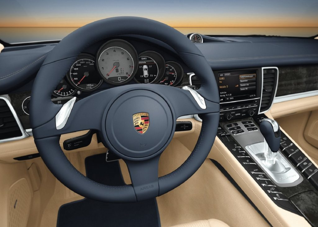 The 2010 Porsche Panamera's steering wheel, gauge cluster, and center console