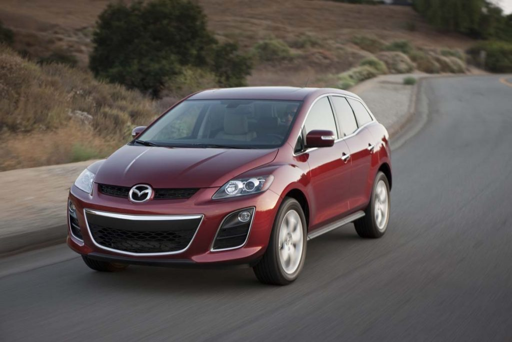 A red Mazda CX-7 on the track.