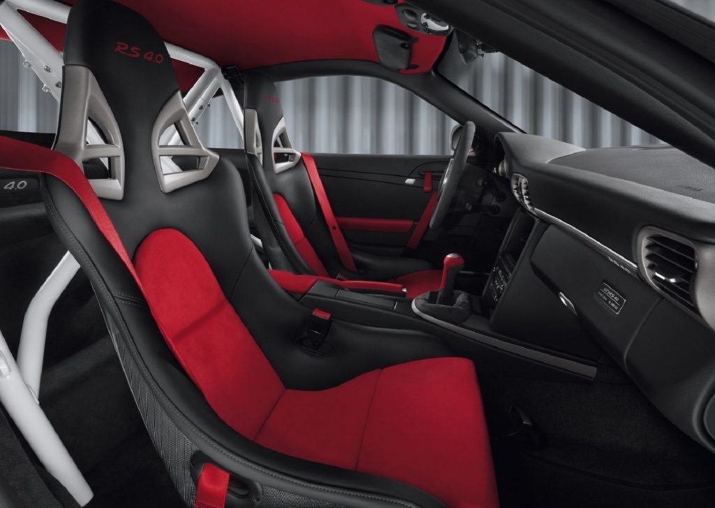 The 2012 Porsche 911 GT3 RS 4.0's red-and-black seats, white roll cage, and black dash