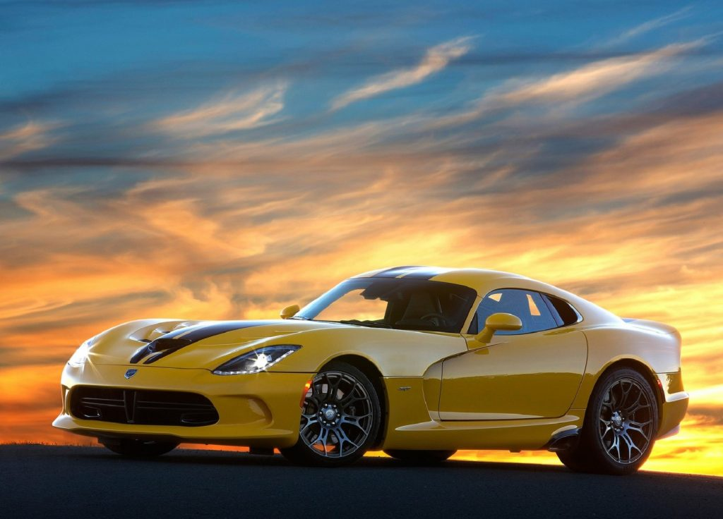 A yellow 2013 SRT Viper at sunset