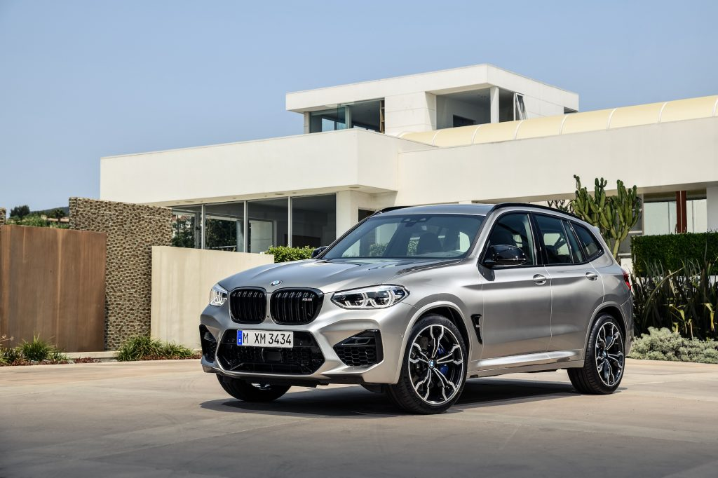 A silver 2019 BMW X3 sits outside a modern house