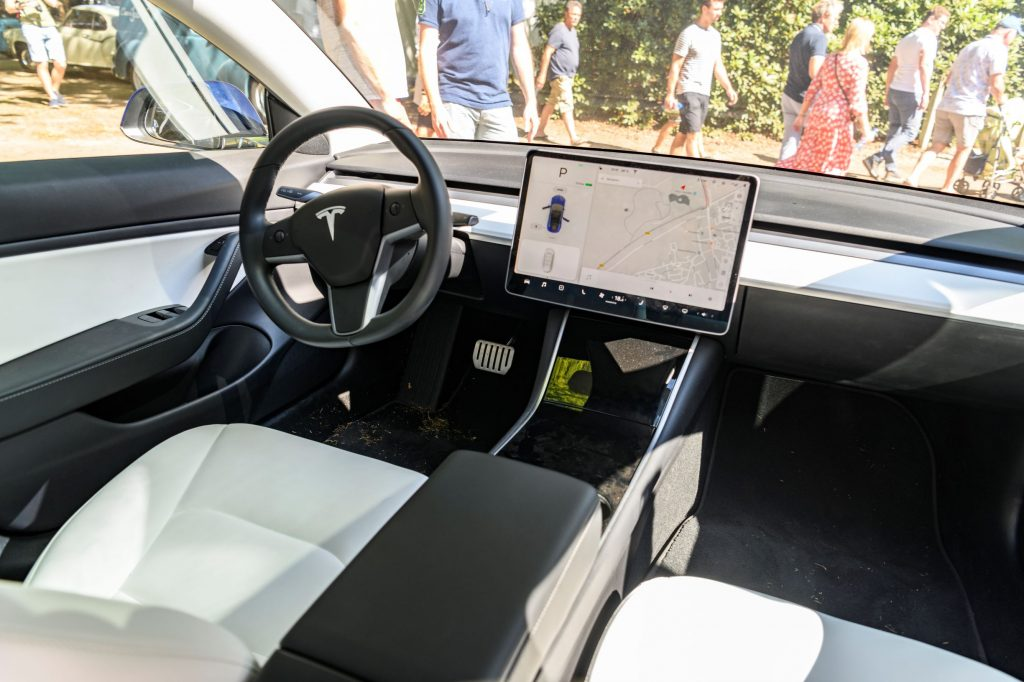 2019 Tesla Model 3 interior with its large central touchscreen