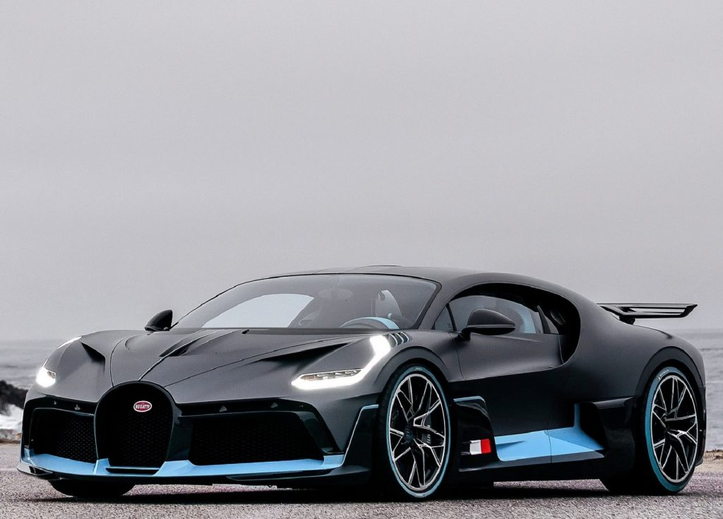 A black-and-blue 2020 Bugatti Divo by a beach