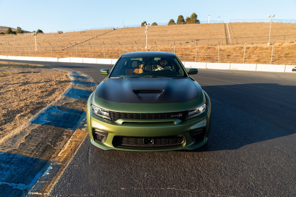 A green 2020 Dodge Charger sits on a racetrack