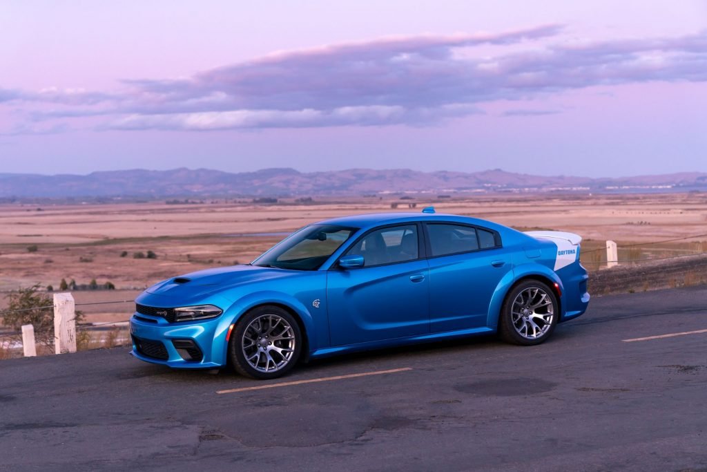 The side view of a blue-and-white 2020 Dodge Charger SRT Hellcat Widebody Daytona 50th Anniversary Edition