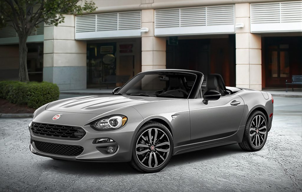 A silver 2020 Fiat Spider 124 parked on display
