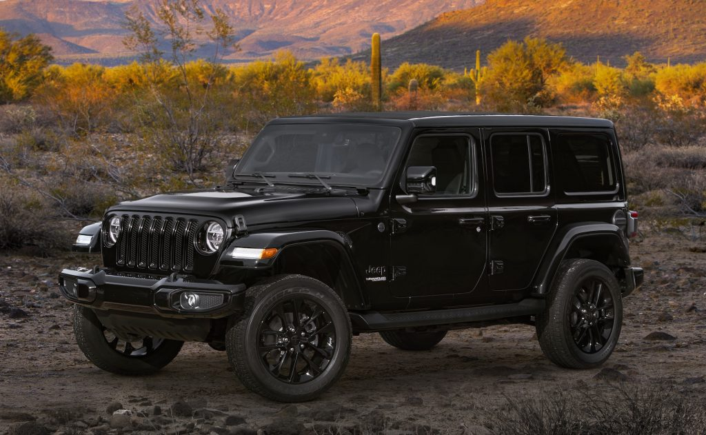 A black 2020 Jeep Wrangler SUV goes off-road.