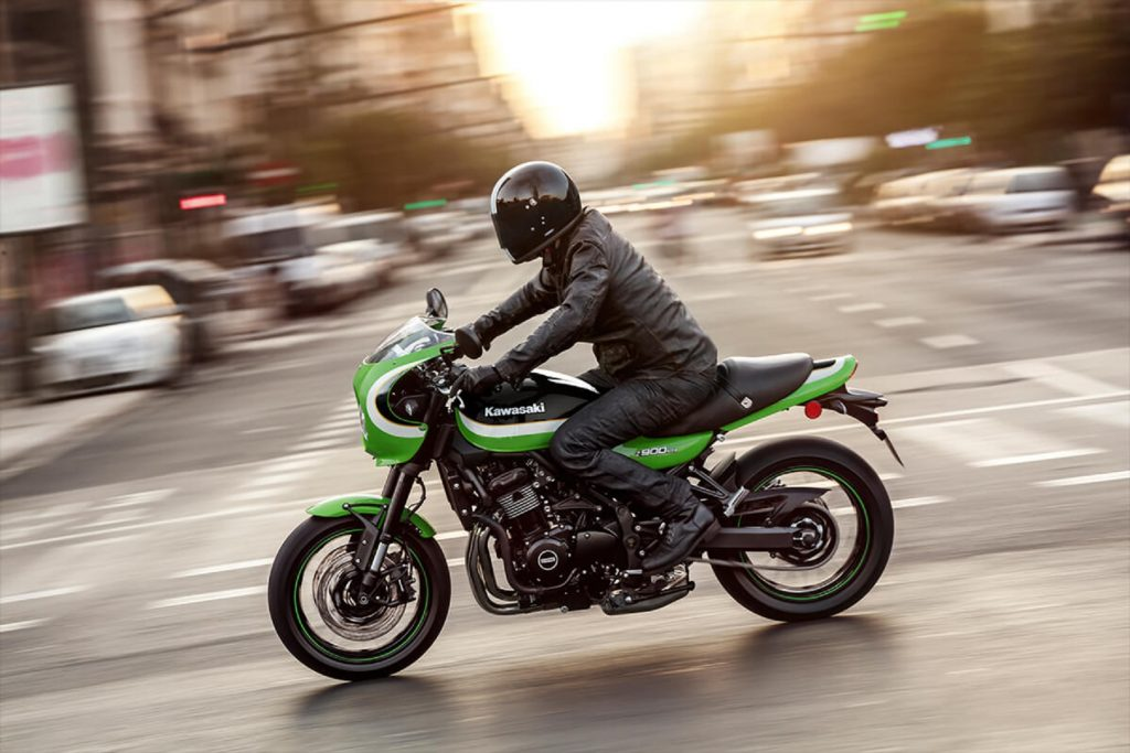 A rider on a green-and-white 2020 Kawasaki Z900RS Cafe