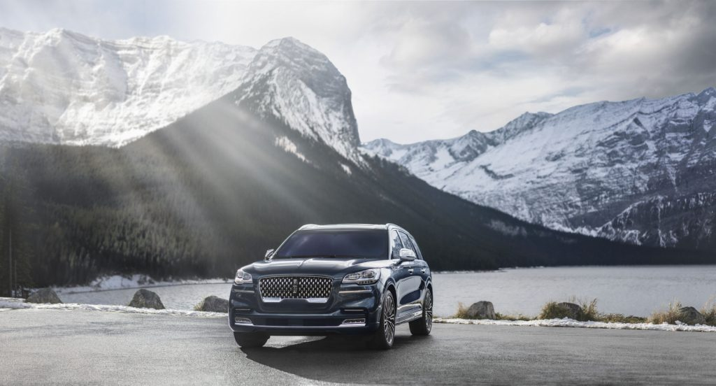 A 2020 Lincoln Aviator parked in front of a snowy mountain