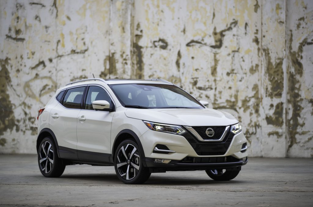 A white 2020 Nissan Rogue Sport on display next to a wall