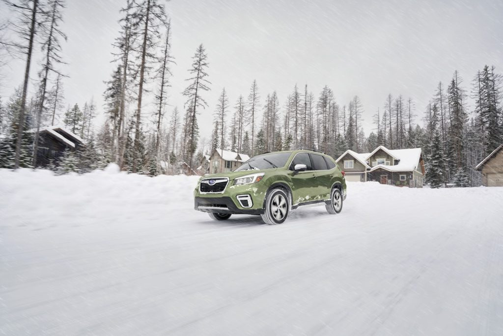A 2020 Subaru Forester drives through the snow.