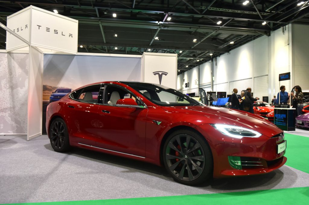 A dark-red 2020 Tesla Model S is displayed during the London Motor and Tech Show at ExCel on May 16, 2019, in London, England