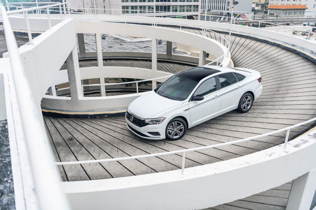 A white 2020 Volkswagen Jetta driving down a ramp
