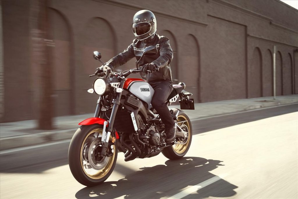 A rider on a red-and-white 2020 Yamaha XSR900