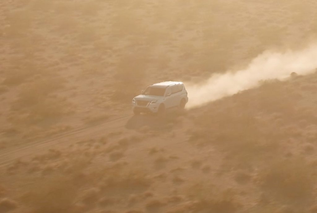 A teaser image of the 2021 Nissan Armada driving through the desert.