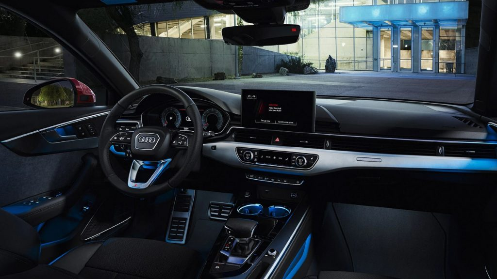 The 2021 Audi A4's blue-lit front seats and dashboard
