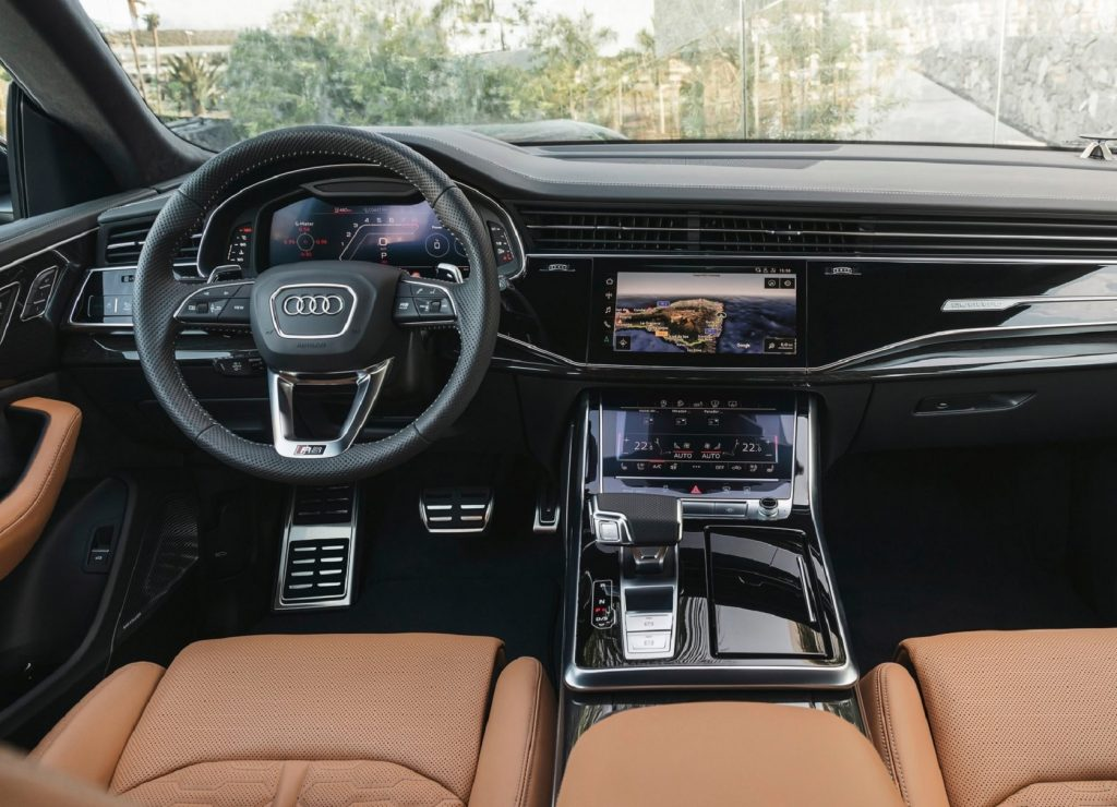The 2021 Audi RS Q8's tan leather front seats and black dashboard