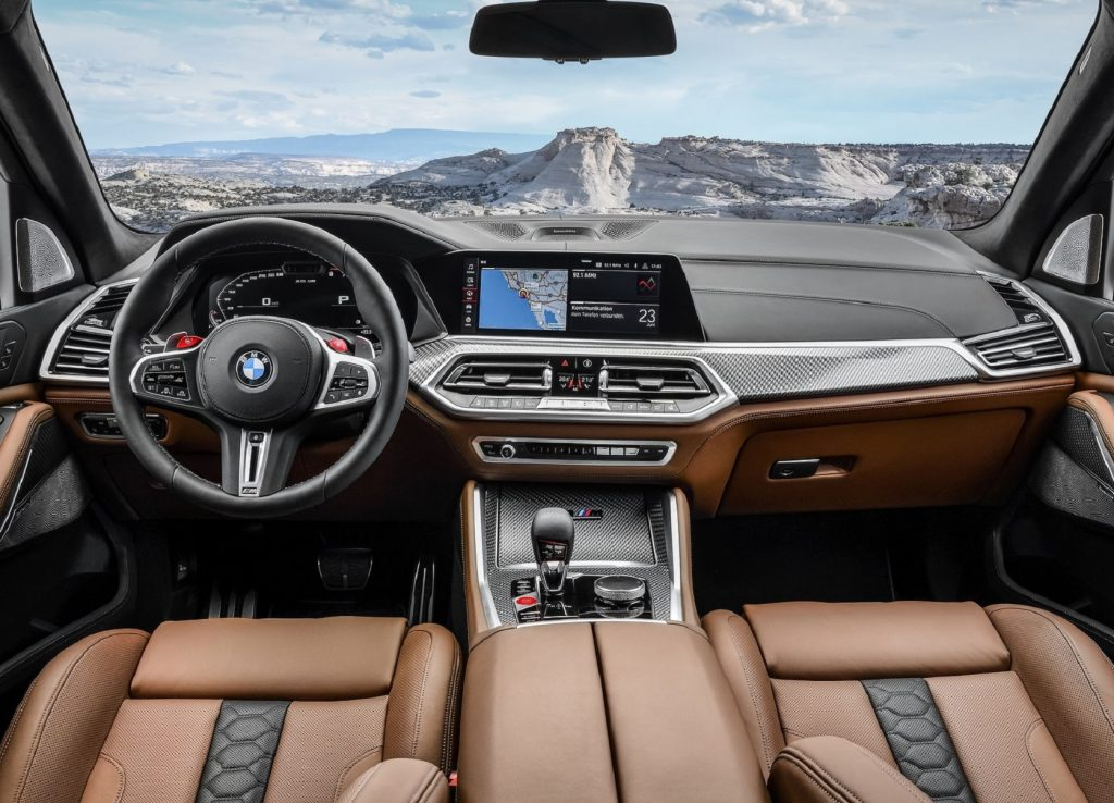 The 2021 BMW X5 M Competition's dashboard and tan-leather front seats