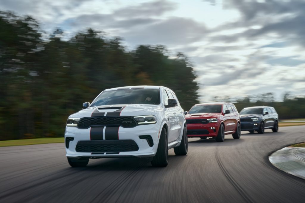 The 2021 Dodge Durango features new aggressive exterior styling, new interior with driver-centric cockpit, new R/T AWD Tow N Go (center) and 710-horsepower SRT Hellcat (left and right).