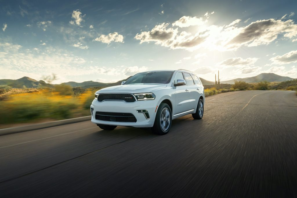 2021 Dodge Durango driving down a sunny road