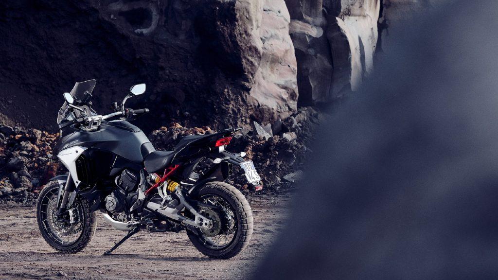 The rear 3/4 view of a silver 2021 Ducati Multistrada V4 S in a quarry