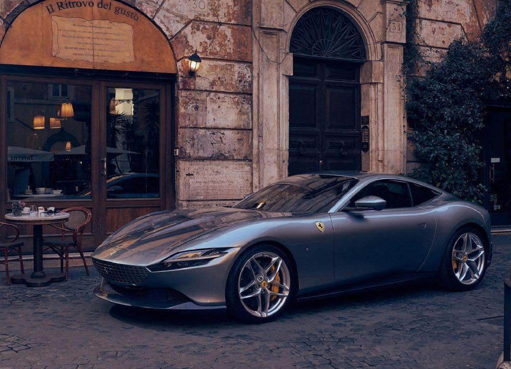 A gray 2021 Ferrari Roma by an Italian cafe
