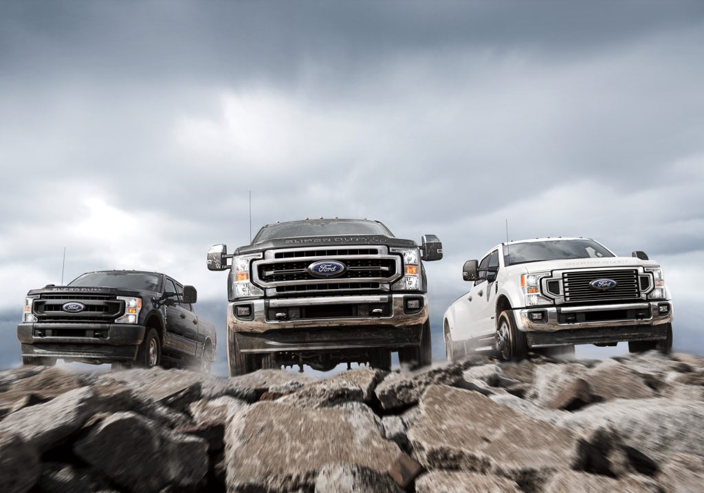 The 2021 Ford F-250, F-350, and F-450 posed on top of rocky terrain.