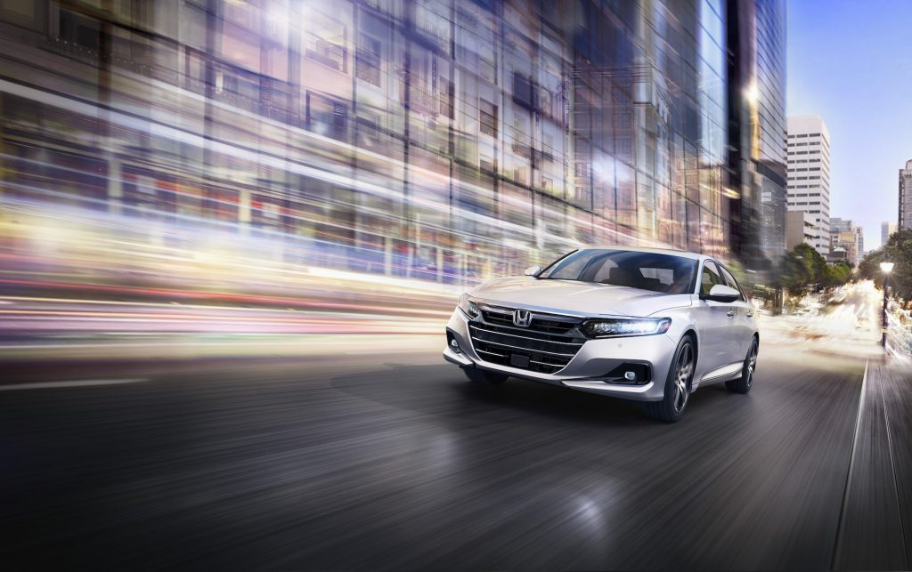 the 2021 Honda Accord Touring at speed in the city at night