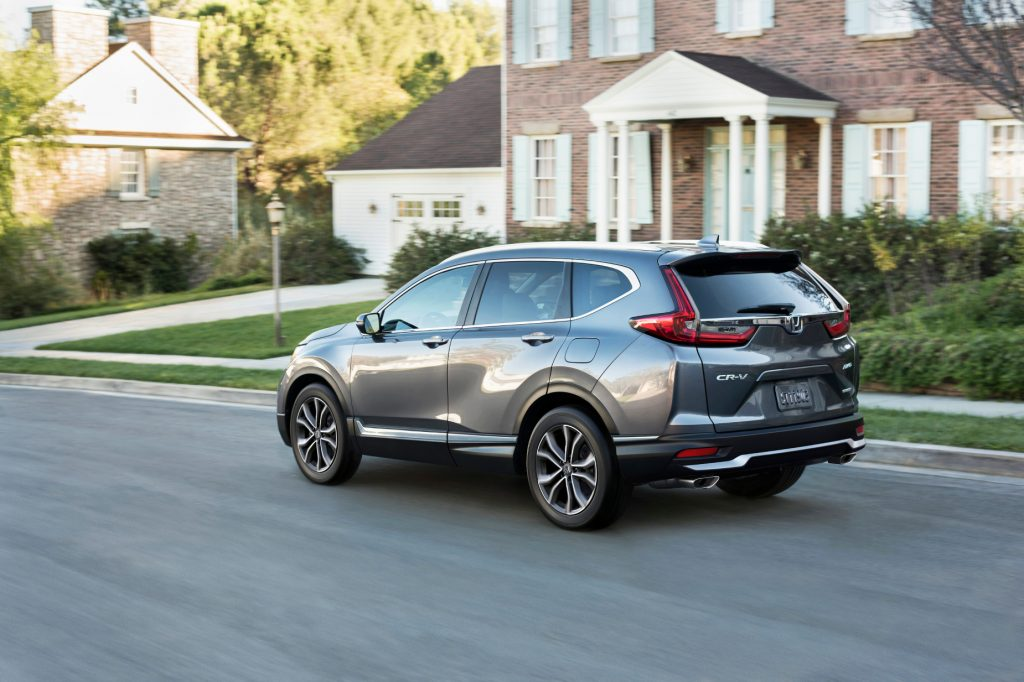 A grey 2021 Honda CR-V driving down a road