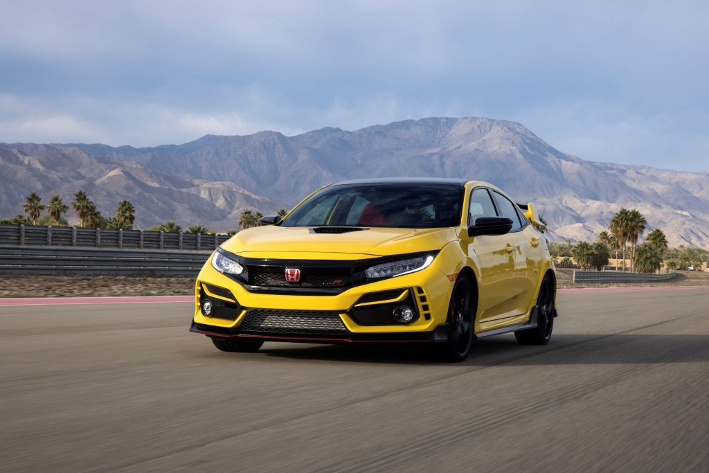 A yellow 2021 Honda Civic Type R Limited Edition driving in front of mountains