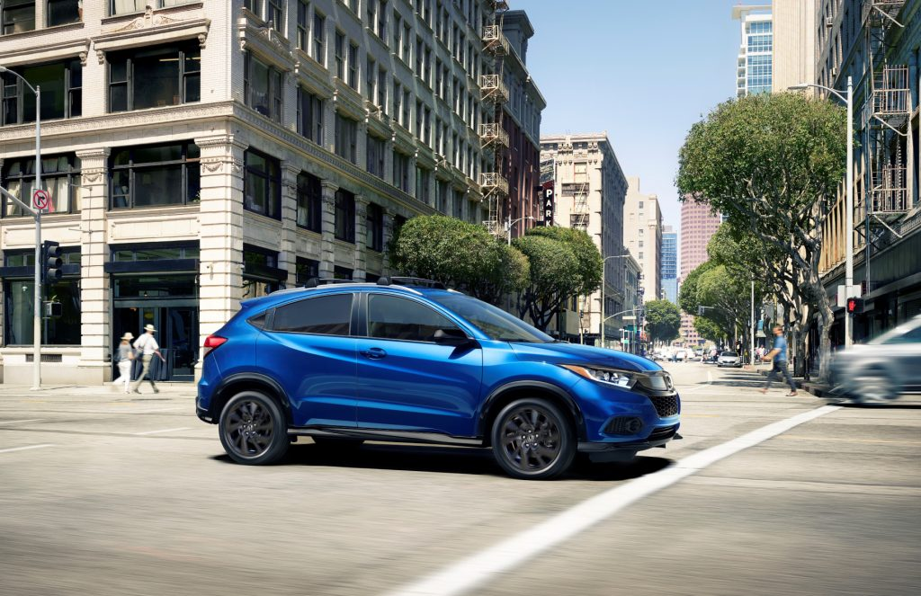 A blue 2021 Honda HR-V driving in the city