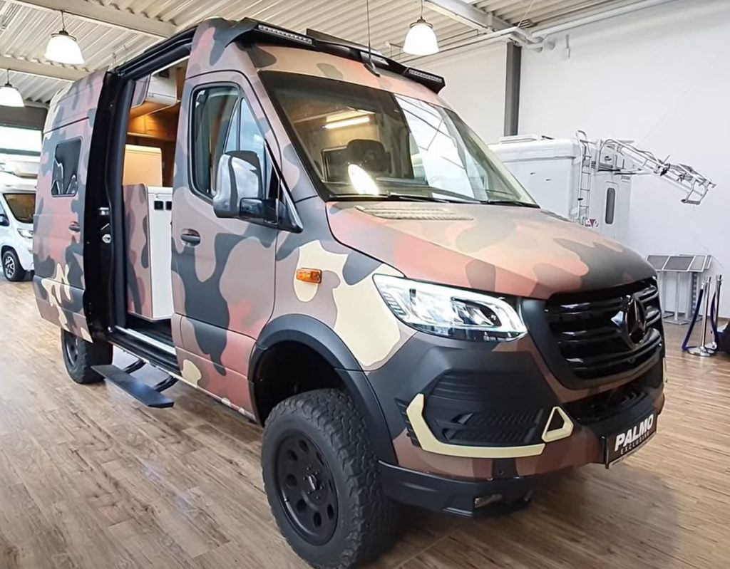 A camouflaged 2021 Hymer Grand Canyon RSX offroad RV