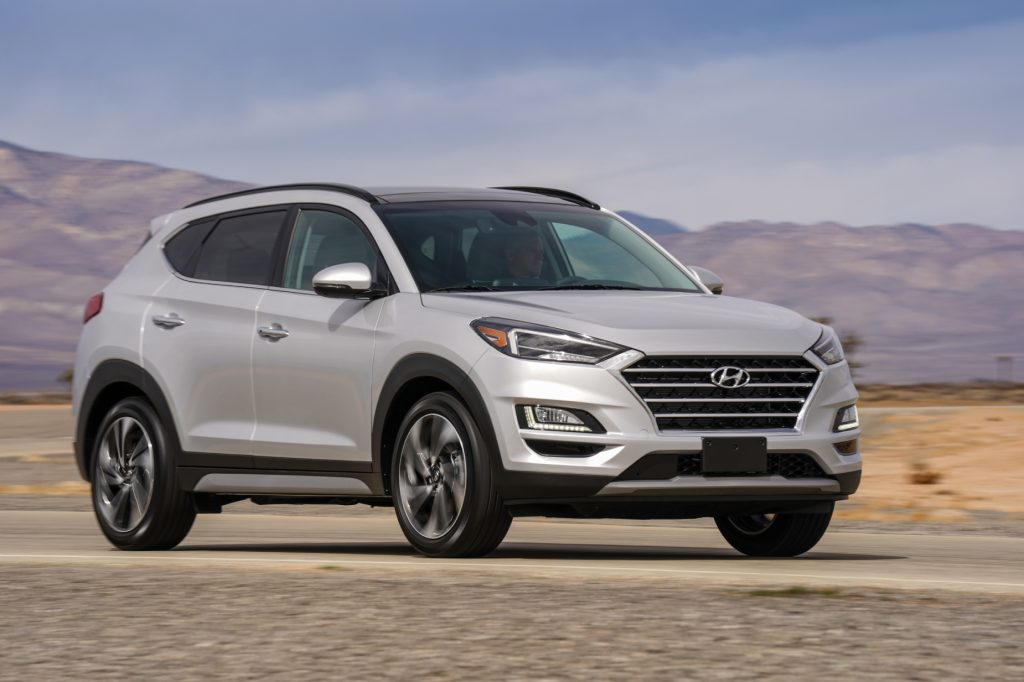 A silver 2021 Hyundai Tucson parked on display