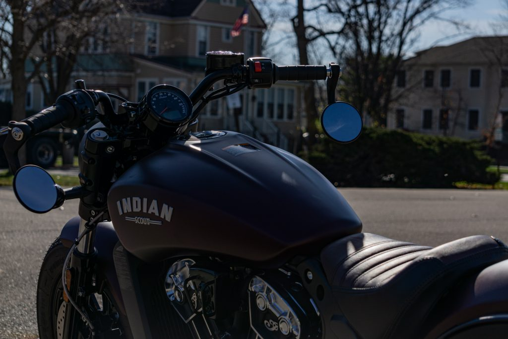 The rear 3/4 view of a 2021 Indian Scout Bobber motorcycle's handlebars and gauge
