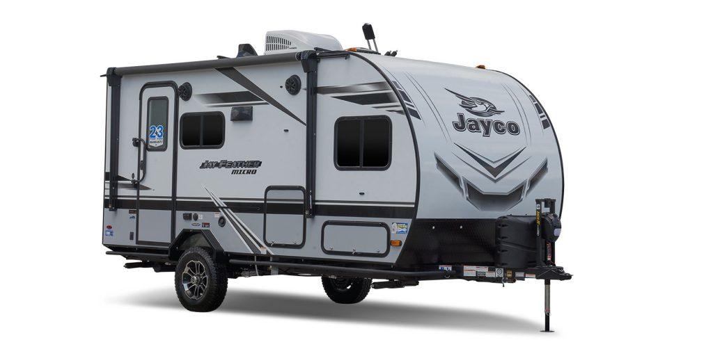A single axle travel trailer.