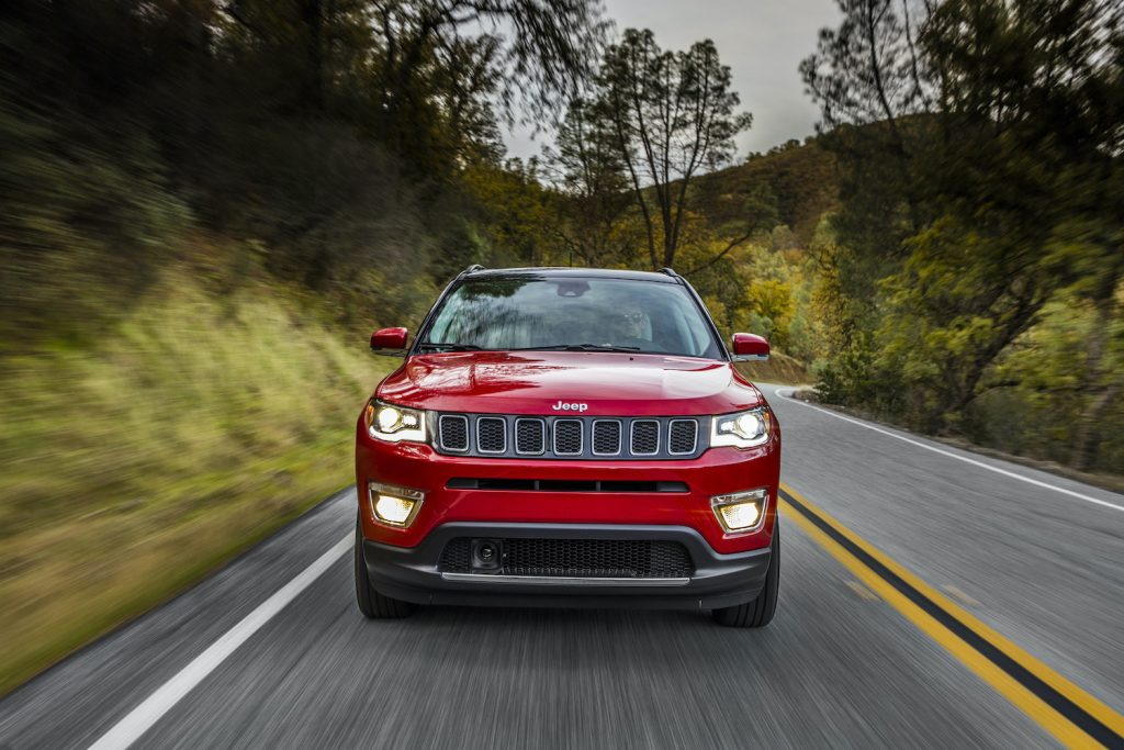 2021 Jeep Compass driving down an empty road