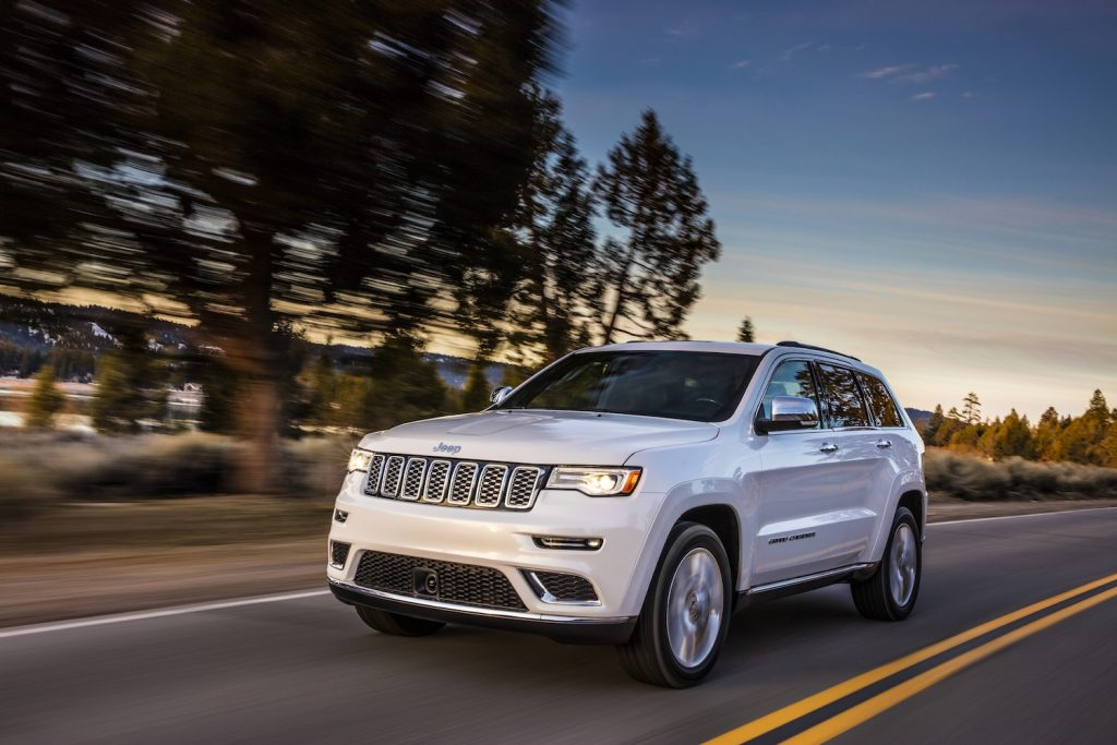2021 Jeep Grand Cherokee Summit driving down the road