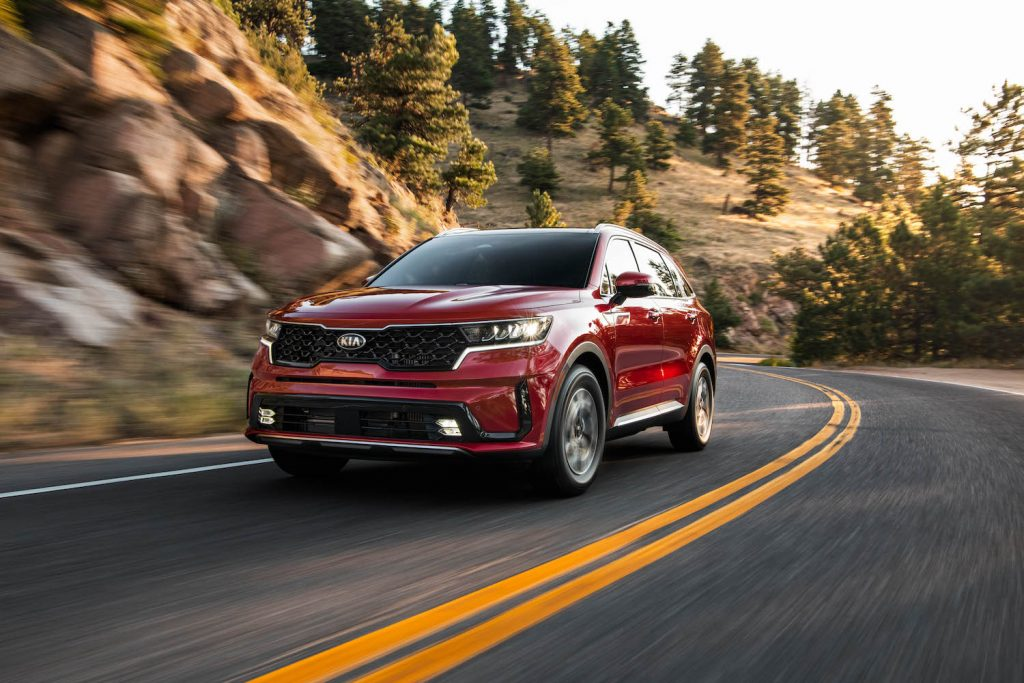 2021 Kia Sorento Hybrid driving around a bend