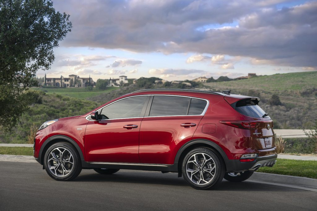 2021 Kia Sportage driving down a road