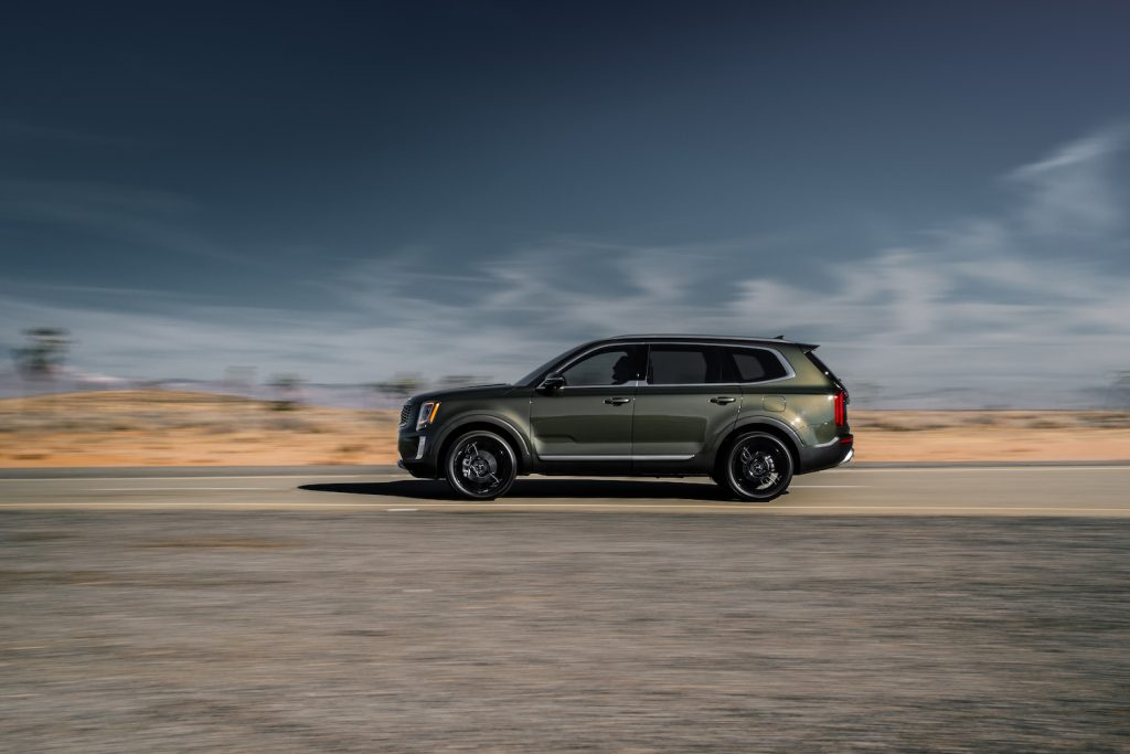 2021 Kia Telluride driving down an empty road
