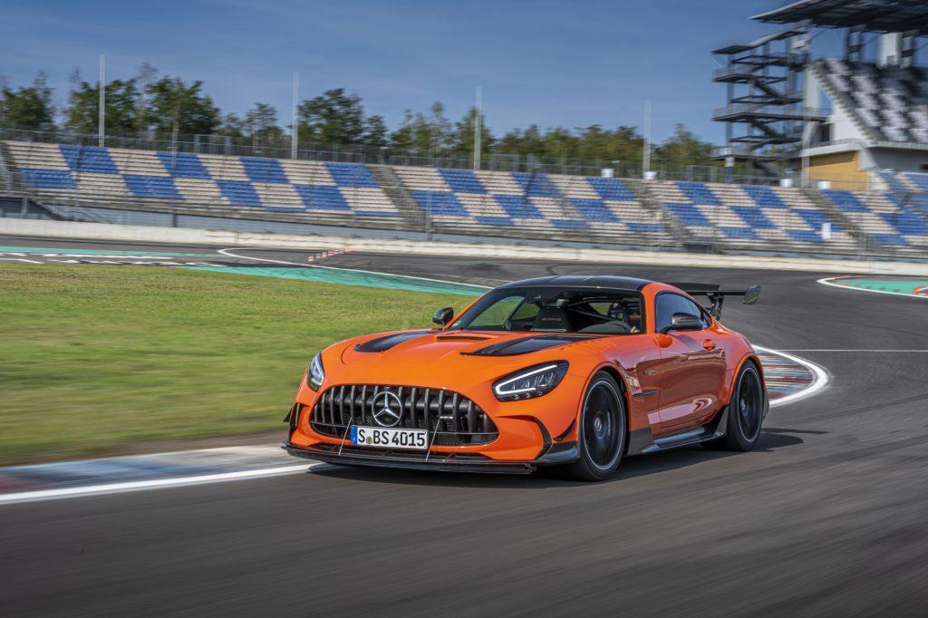 An orange 2021 Mercedes-AMG GT Black Series going around a corner on a race track