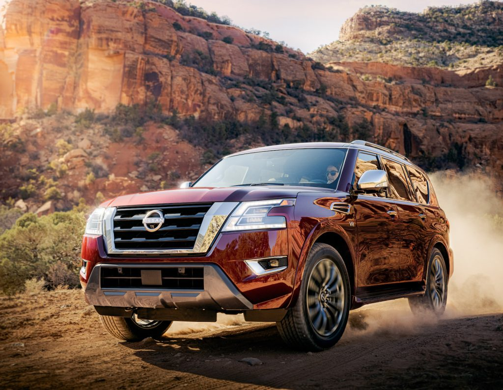 A red 2021 Nissan Armada off-road.