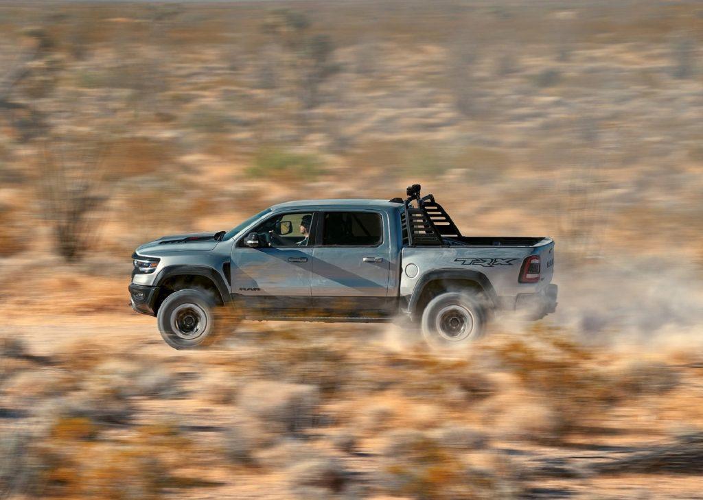 A gray 2021 Ram 1500 TRX 1st Edition races through the desert