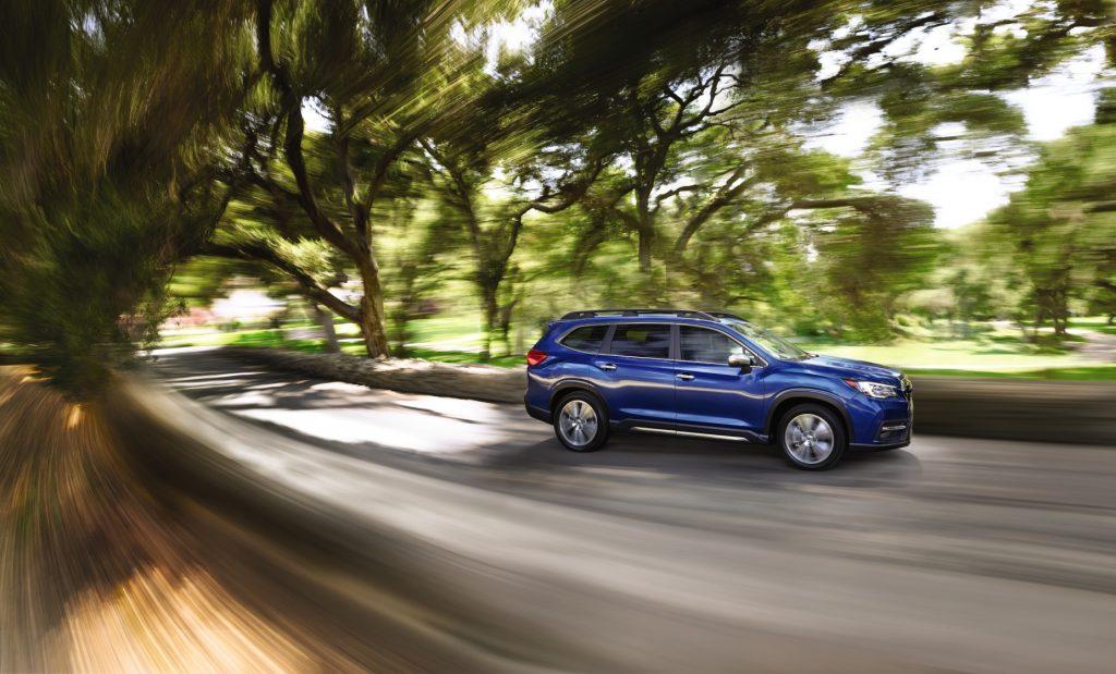 A blue 2021 Subaru Ascent driving down a road
