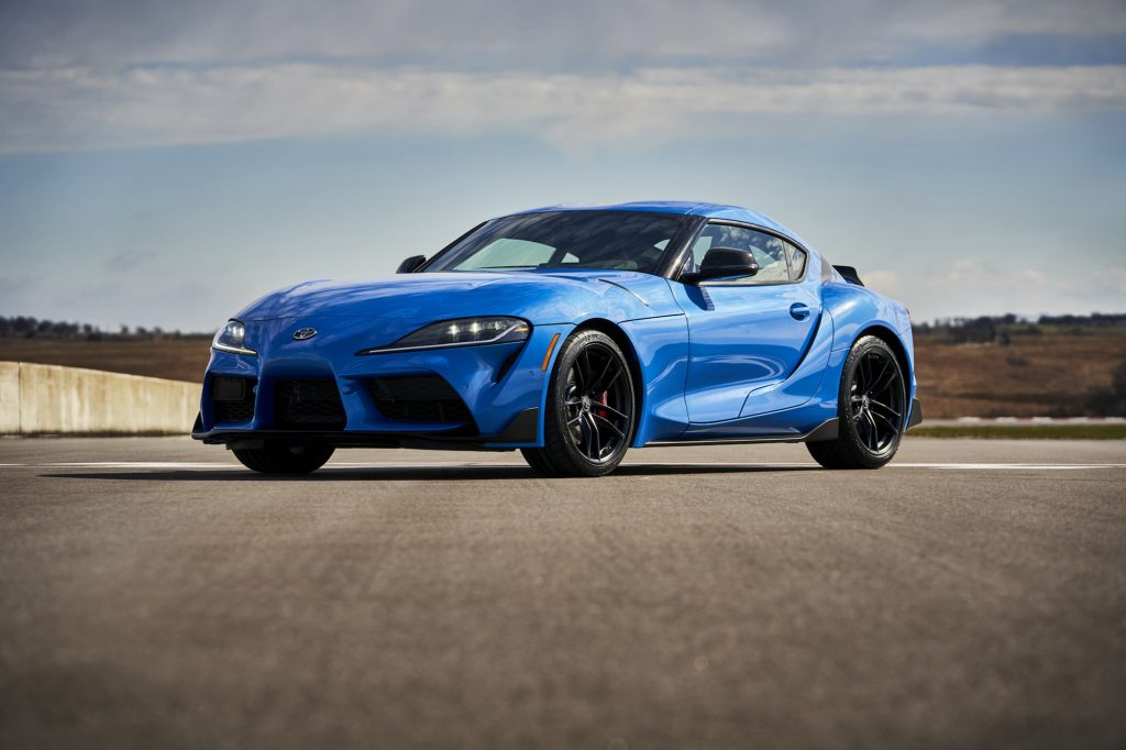 A bright-blue 2021 Toyota GR Supra A91 Edition is parked on a racetrack