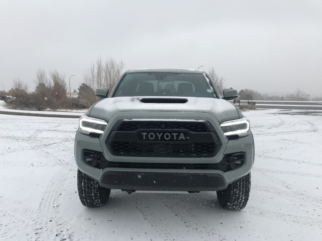Front grille view of a 2021 Toyota Tacoma TRD Pro in the snow