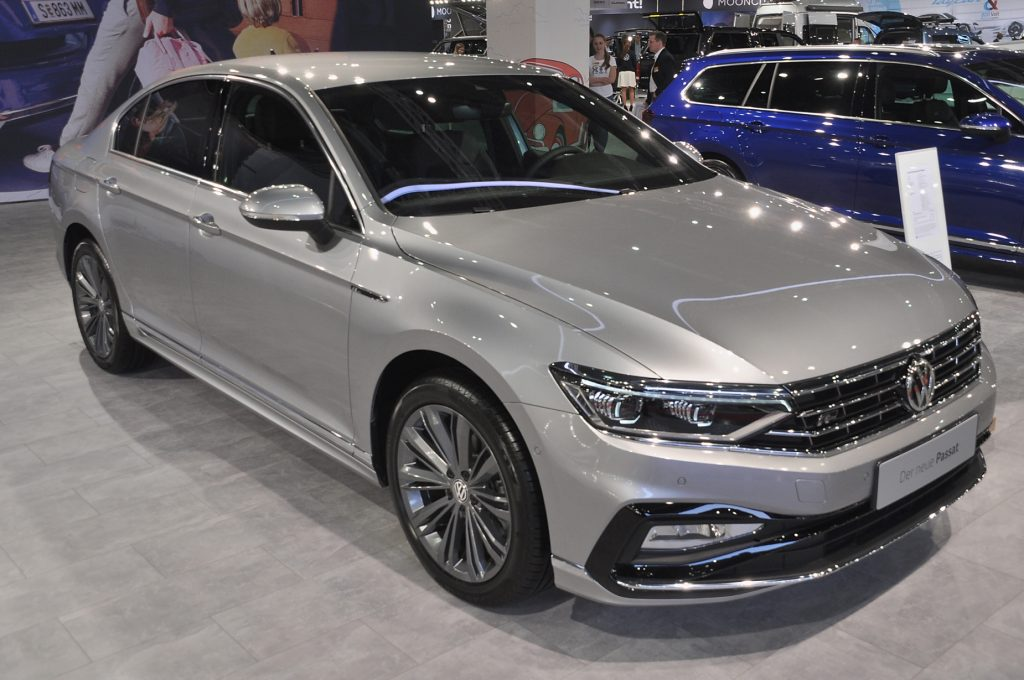 A silver Volkswagen Passat on display at an autoshow