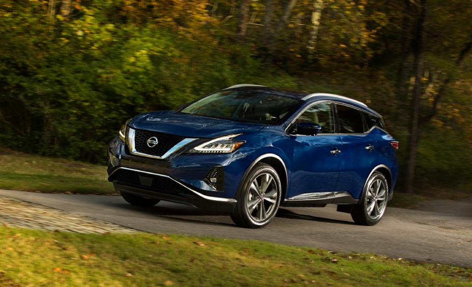 a blue 2021 murano driving on a scenic road