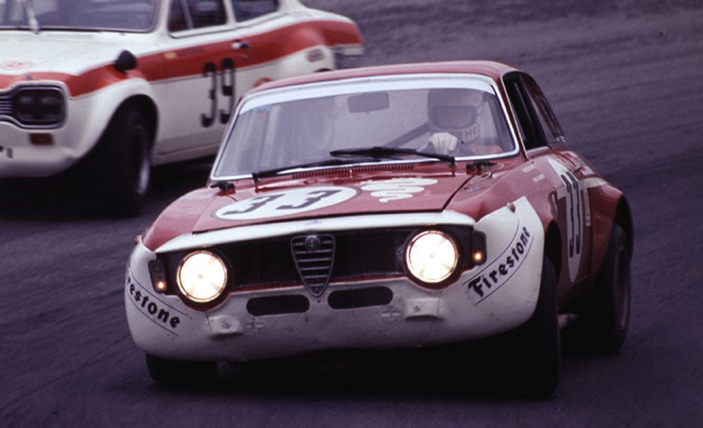 A white-and-red Alfa Romeo GTA 1300 Junior race car