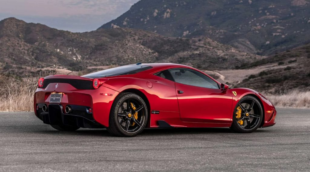 The rear 3/4 view of an armored red Ferrari 458 Speciale